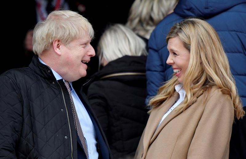 Britain's Prime Minister Boris Johnson with his partner Carrie Symonds at Twickenham Stadium, London, Britain, March 7, 2020. Photo: Reuters/File