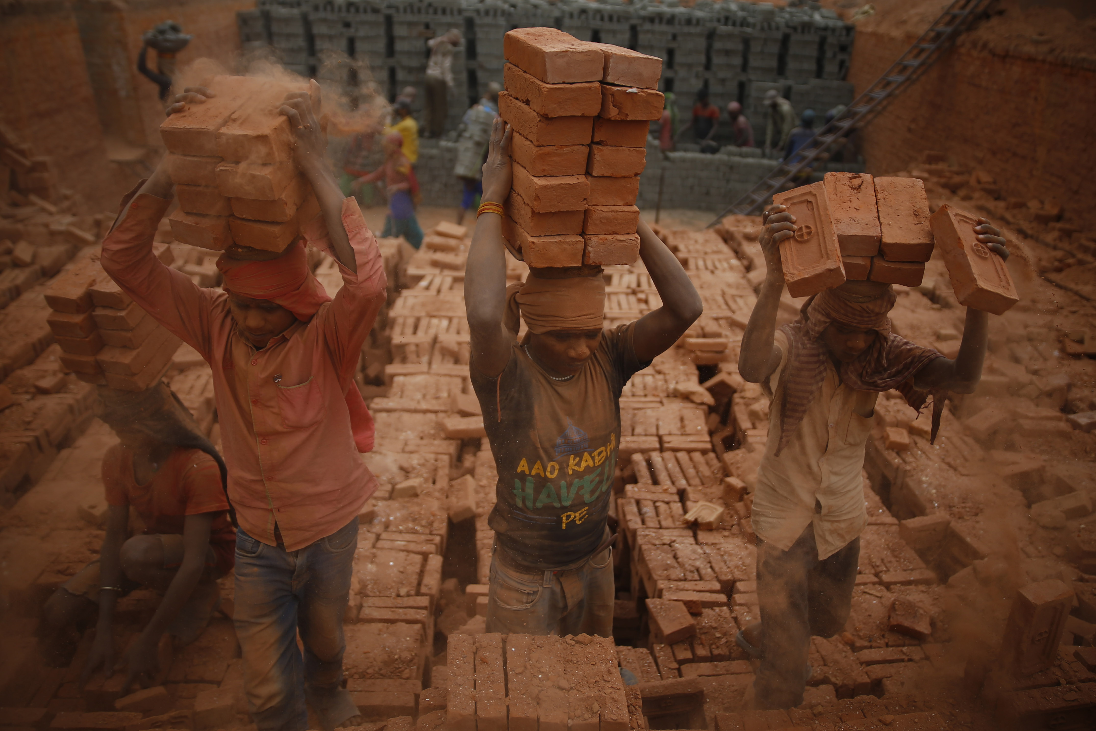Labourers work at a brick kiln a day ahead of Labour Day, on the 38th day of government-imposed lockdown, amid concerns over the spread of coronavirus contagion, in Bhaktapur, on Thursday, April 30, 2020. Photo: Skanda Gautam/THT