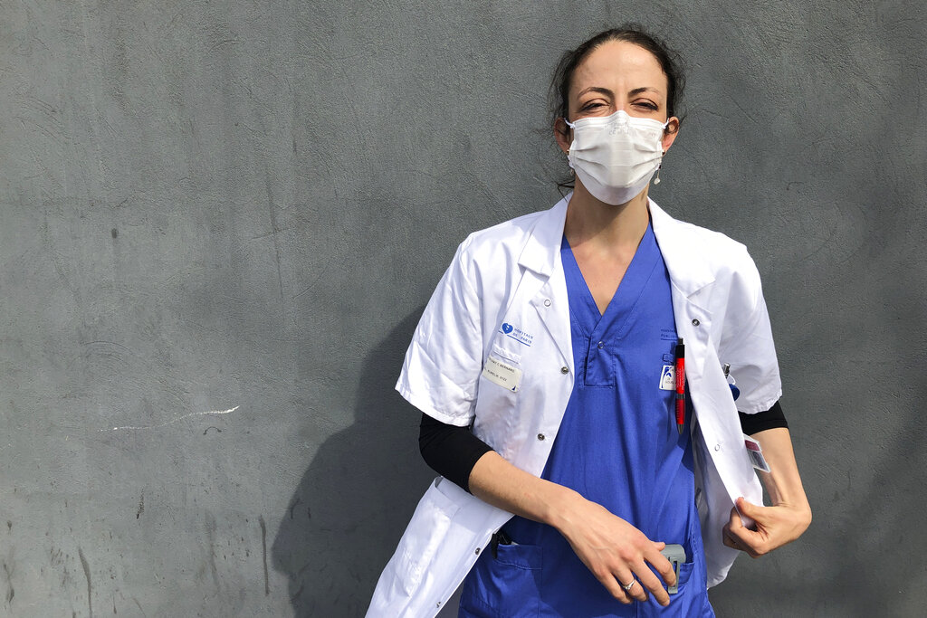 In this photo taken on Tuesday, April 7, 2020, Aurelie Gouel, an ICU doctor, poses during a break in her shift treating COVID-19 patients at Bichat Hospital in Paris. Gouel was infected by the new coronavirus in March but rushed back to work as soon as she recovered from her high fever, cough and other symptoms because she felt compelled to rejoin the fight to save lives.  The coronavirus has infected so many doctors, nurses and other health workers that some are now returning to work hoping that they are now armed with some degree of immunity. Photo: AP