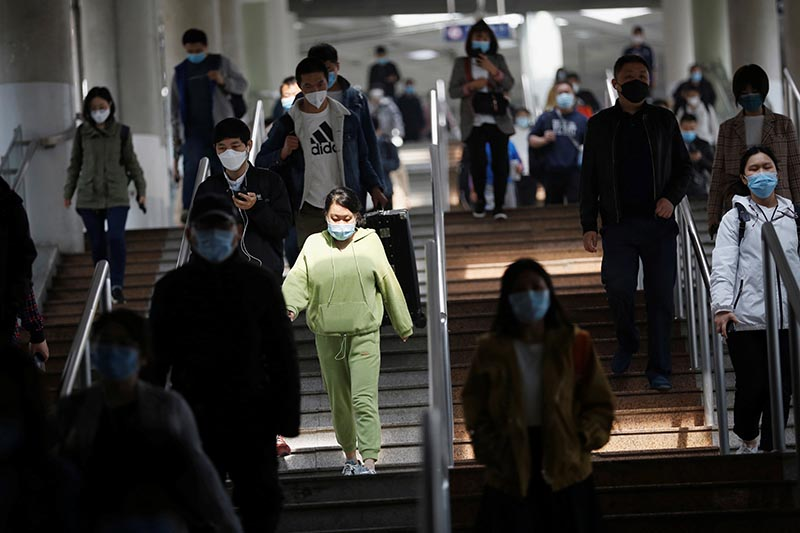 People wearing face masks walk inside a subway train during morning rush hour in Beijing, as the spread of the novel coronavirus disease (COVID-19) continues in the country, China April 14, 2020. Photo: Reuters
