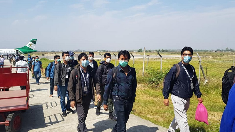 A team of doctors heading for exit upon arrival at Dhangadhi Airport in Kailali district, on Friday, April 17, 2020. Photo: RSS