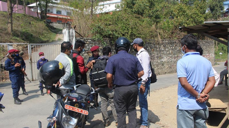 Security personnel barring journalists to enter the District Administration Office ion Dhankuta, on Tuesday, March 7, 2020. Photo: Khagendra Ghimire/THT