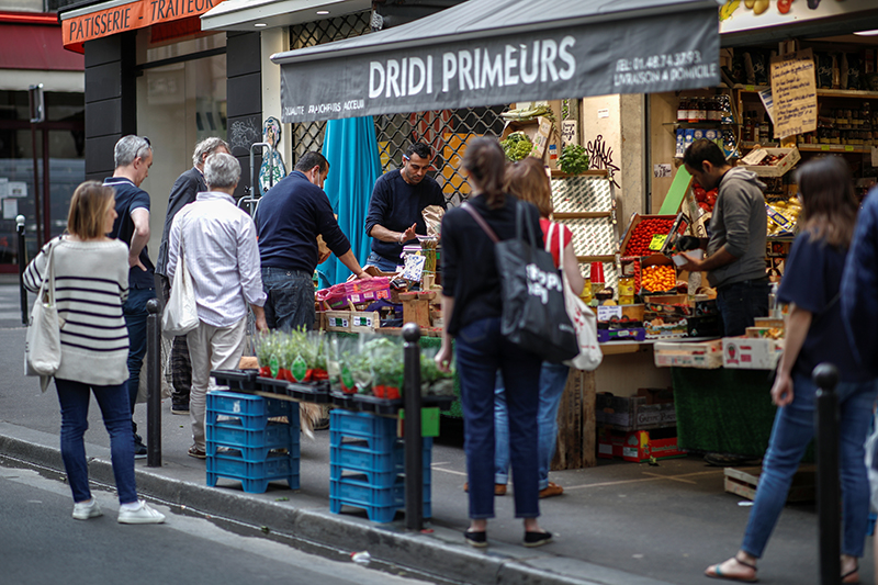People queue in front of a fruit and vegetables shop at Rue des Martyrs, as the spread of the coronavirus disease (COVID-19) continues in Paris, France, on April 18, 2020. Photo: Reuters
