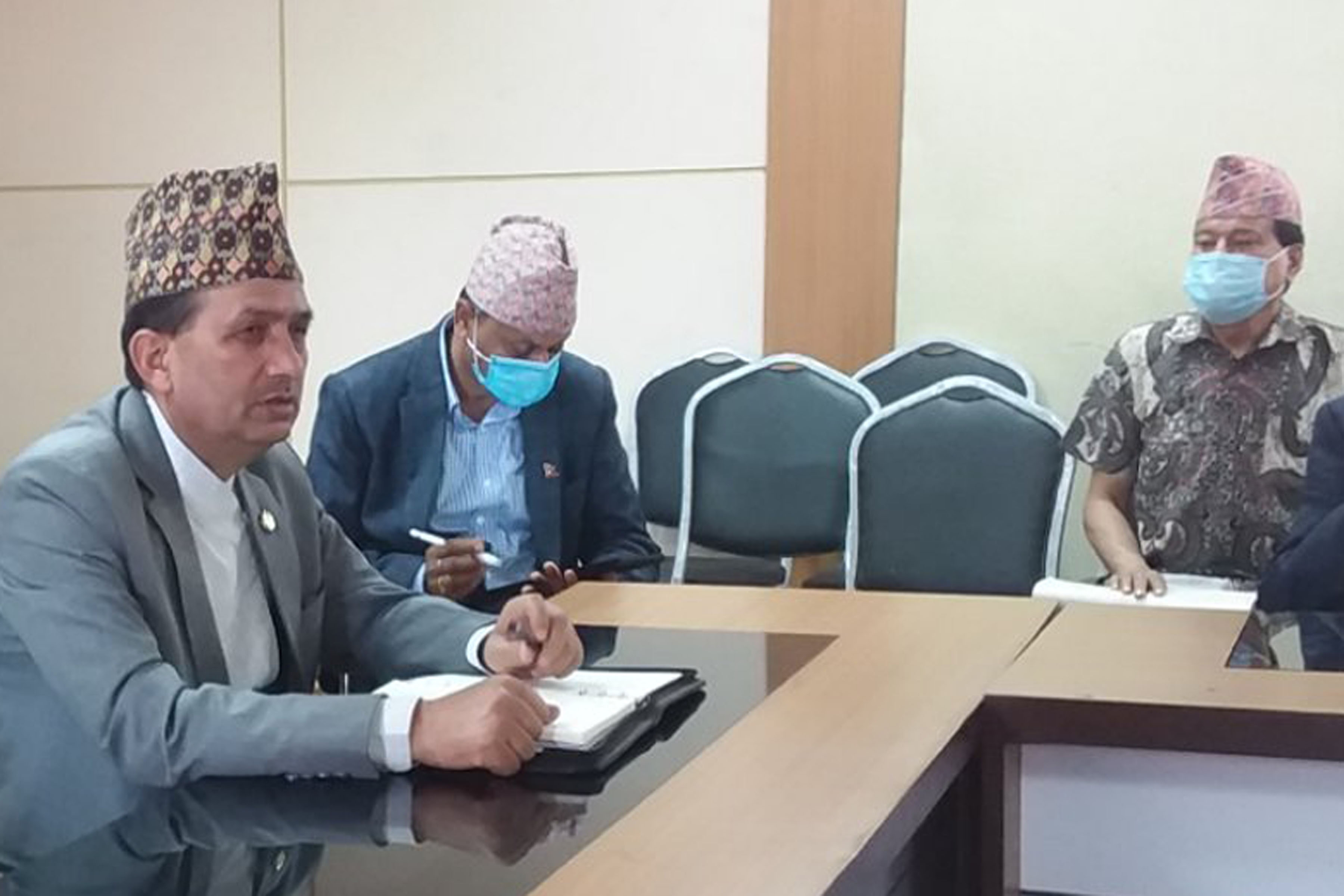 Minister for Health and Population Bhanu Bhakta Dhakal (left) takes part in an interaction with experts at the Ministry, on Saturday, April 4, 2020. Photo: MoHP via RSS