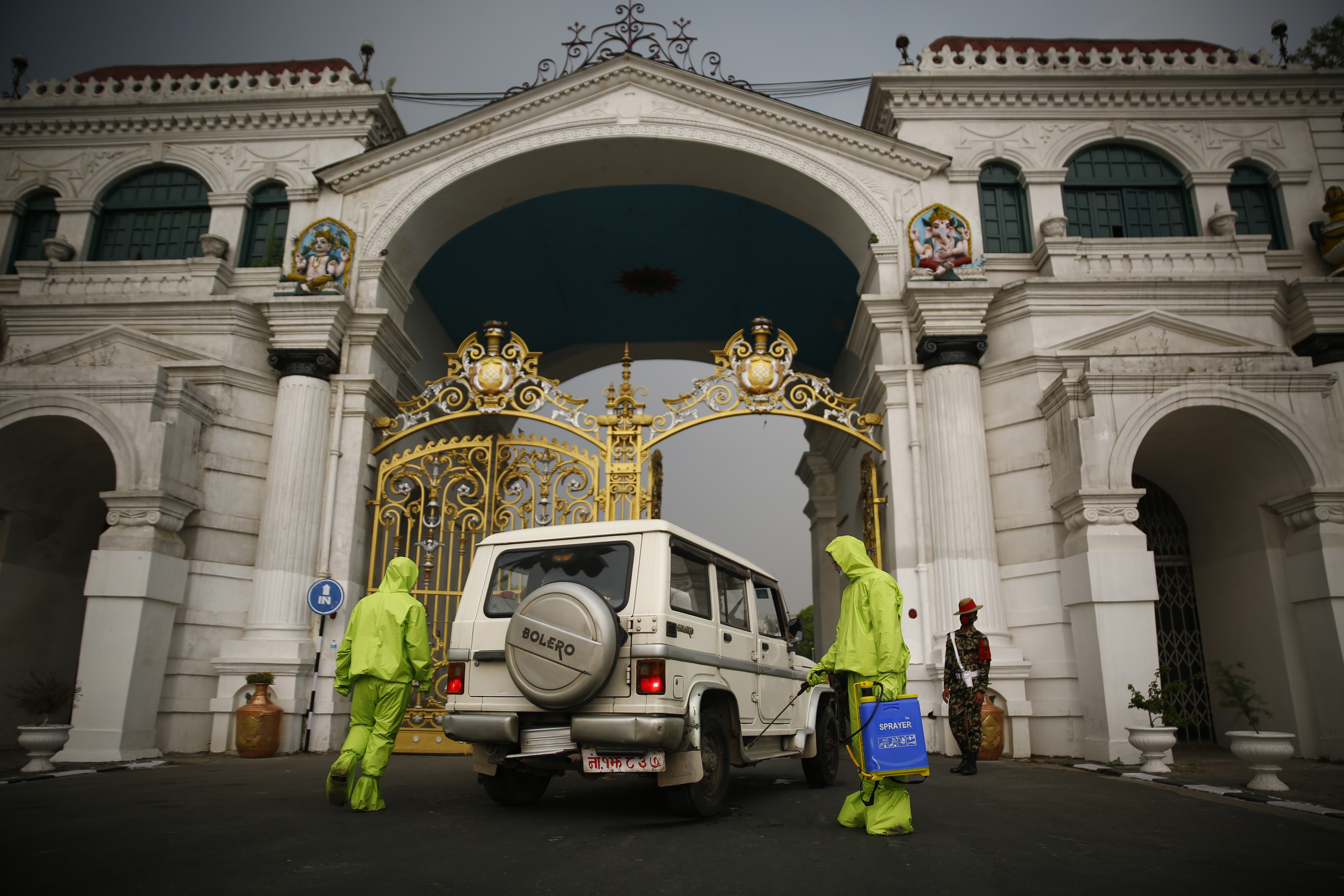 Nepal Army personnel disinfect a government vehicle entering Singha Durbar on the 19th day of government-imposed nationwide lockdown, amid concerns over the spread of COVID-19 infection, in Kathmandu, on Saturday, April 11, 2020. Photo: Skanda Gautam/THT
