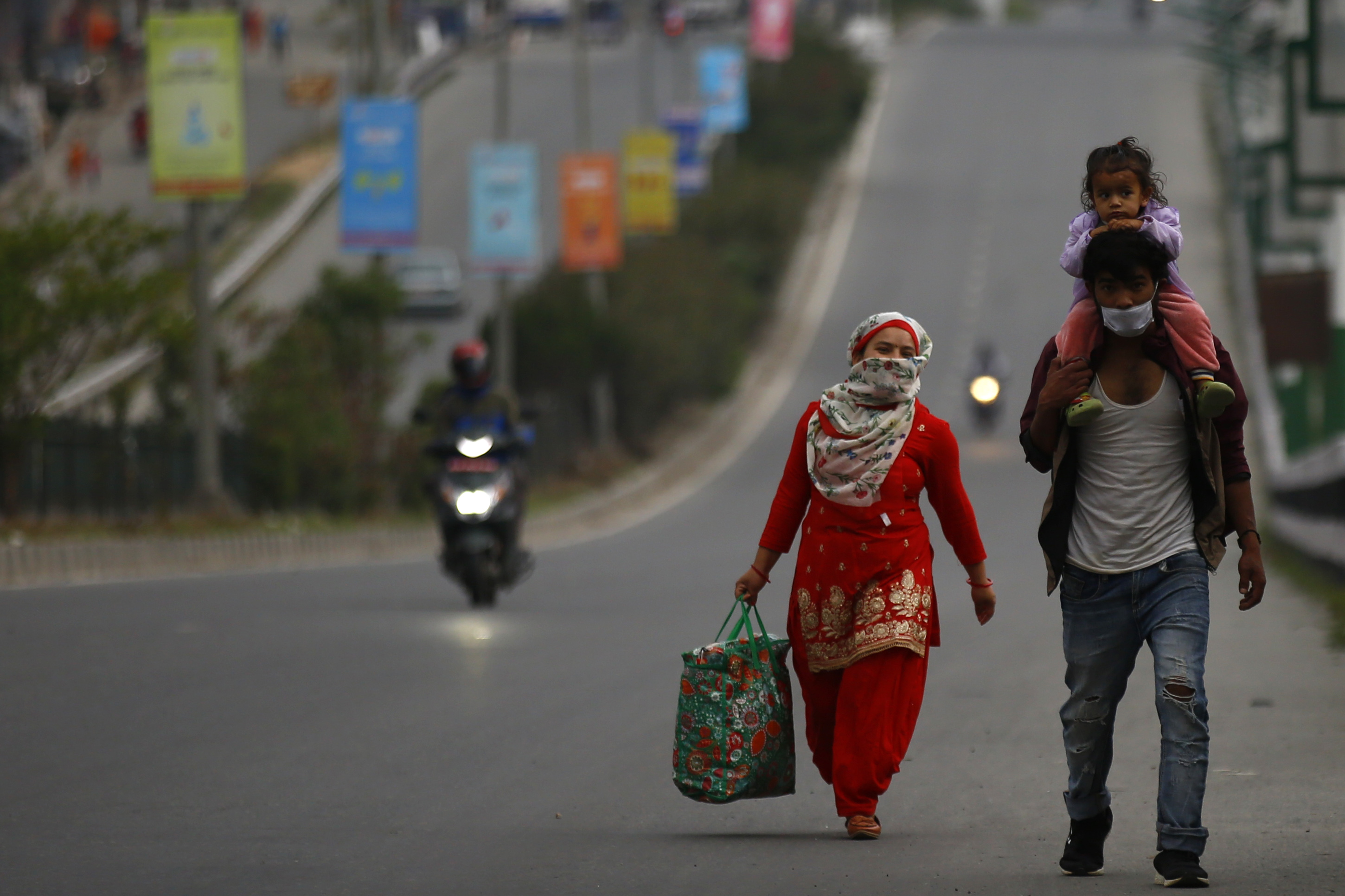 Stranded family members walk a long distance to reach their village on the 27th day of the government imposed lockdown amid concerns over the spread of the coronavirus outbreak in Bhaktapur, on Sunday, April 19, 2020. Photo: Skanda Gautam/THT