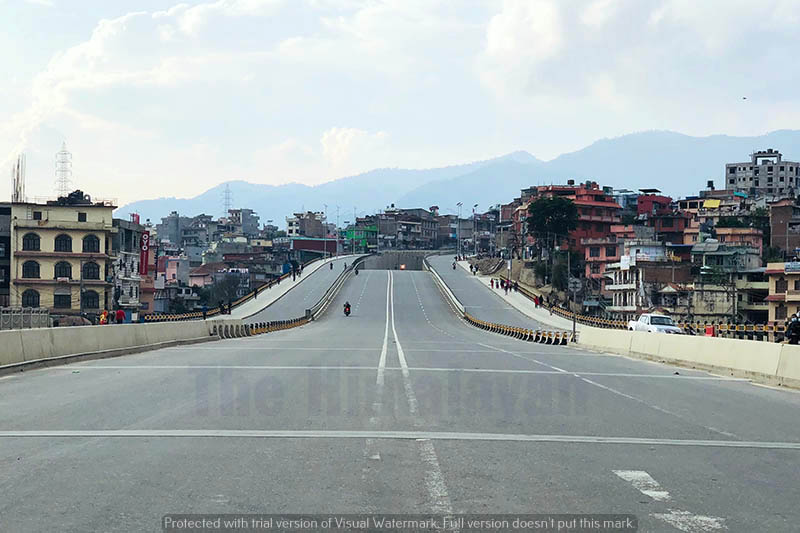 Pedestrians walk along the deserted road during the 34th day of government-imposed lockdown in Kalanki, Kathmandu, on Sunday, April 26, 2020. Photo: Mausam Shah Nepali/THT