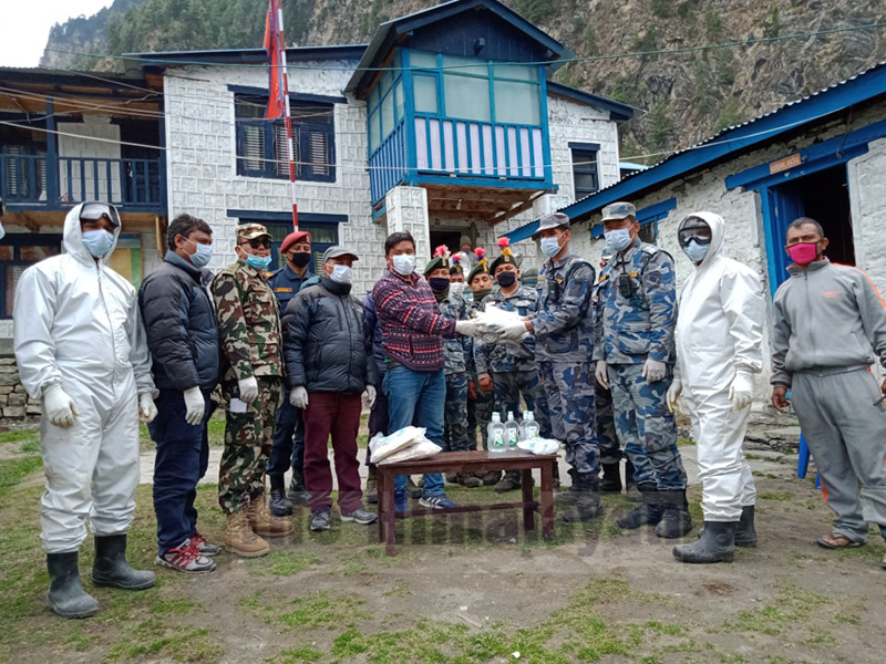 Armed Police Force hands over health equipment to a local, in Chame Rural Municipality, Manang. Photo: Ramji Rana/THT