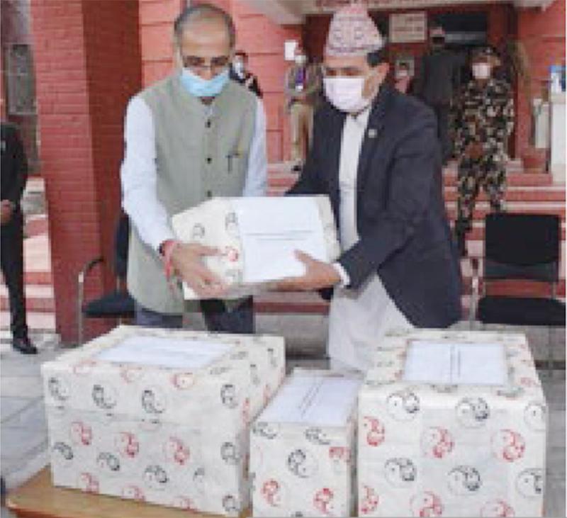 Ambassador of India Vinay Mohan Kwatra handing over medicines to Minister of Health and Population  Bhanubhakta Dhakal, in Kathmandu, on Wednesday, April 22, 2020. Photo: THT