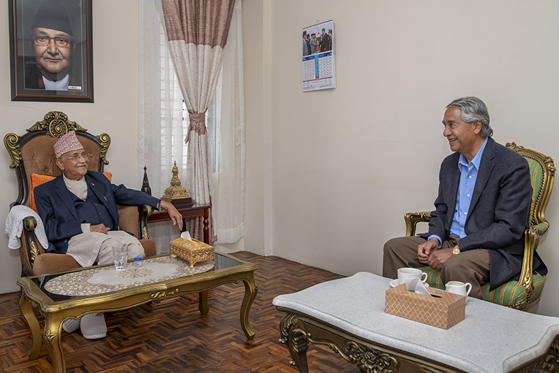 Prime Minister KP Sharma Oli and former Prime Minister and Nepali Congress President Sher Bahadur Deuba during a meeting held at Baluwatar, in Kathmandu, on Friday, April 24,2020. Photo: Rajan Kafle/ Private Secretariat of the Prime Minister