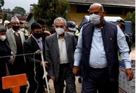 FILE - Janata Samajwadi Party lawmakers Surendra Yadav (right) and Baburam Bhattarai on their way to lodge an FIR against former IG Sarvendra n Khanal and Nepal Communist Party (NCP) lawmakers Mahesh Basnet and Krishna Kumar Shrestha, in Teku, Kathmandu, on Sunday.  Photo: Naresh Shrestha/THT