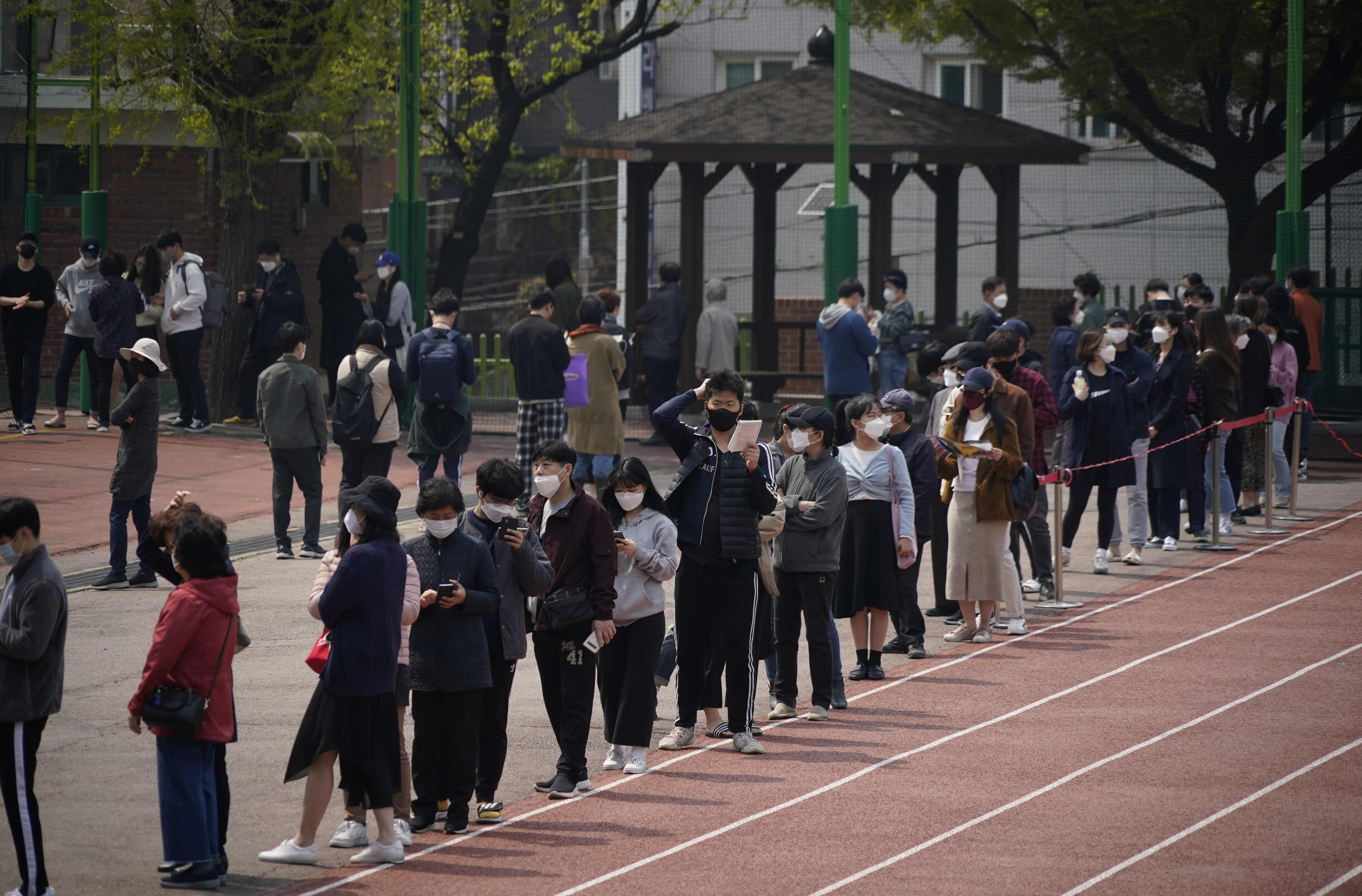 Voters wearing face masks in an effort to prevent the spread of the coronavirus disease (COVID19) wait in line to cast their ballots at a polling station during the parliamentary election in Seoul, South Korea, on April 15, 2020. Photo; Reuters