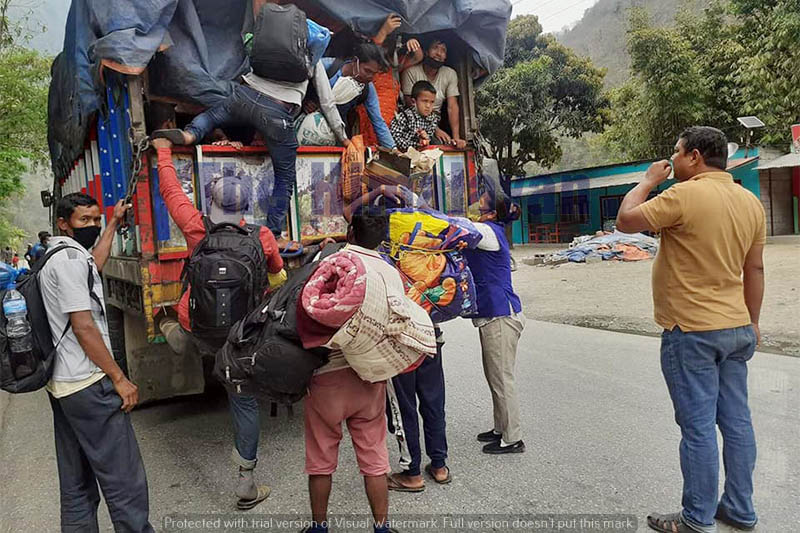 Stranded pedestrians boarding a truck on their way to Mauwakhola along the Prithivi Highway between Chitwan and Dhading districts, on Friday, April 17, 2020. Photo: Keshav Adhikari/THT