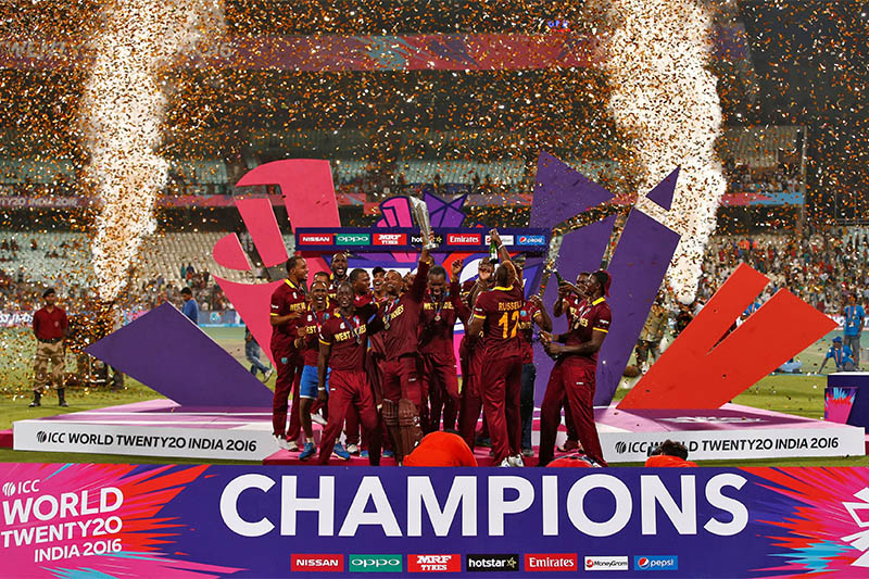 FILE PHOTO: West Indies players celebrate with the trophy after winning the final. Photo: Reuters