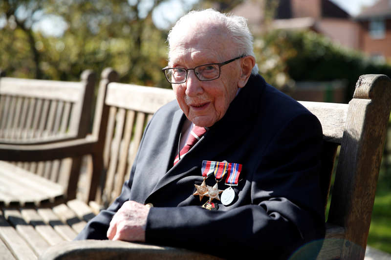 Retired British Army Captain Tom Moore, 99, poses after he continued to raise money for health workers, by attempting to walk the length of his garden one hundred times before his 100th birthday this month as the spread of coronavirus disease (COVID-19) continues, Marston Moretaine, Britain, April 15, 2020. Photo: Reuters