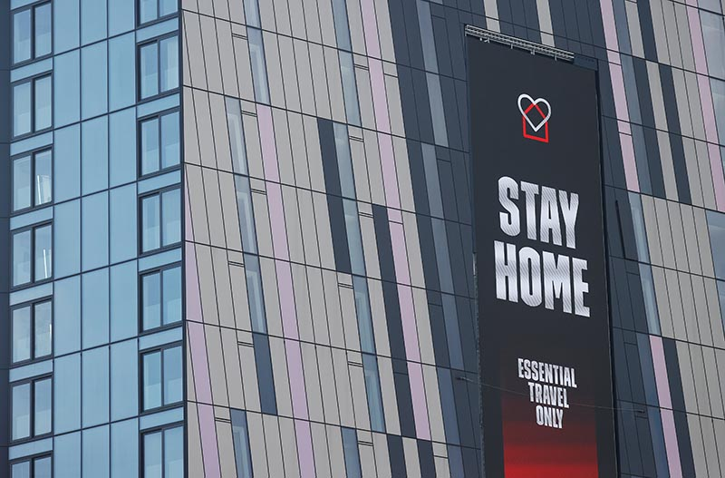A message is seen on the side of a tower block in Manchester as the spread of the coronavirus disease (COVID-19) continues, Manchester, Britain, on April 11, 2020. Photo: Reuters