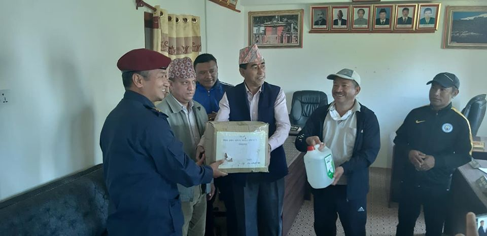 Chief of District Police Office, Bhojpur, Deputy Superintendent of Police (DSP) Nar Bahadur Salami Magar being handed over the facemaks, in Bhojpur district, on Friday, April 10, 2020. Photo: Niroj Koirala/THT
