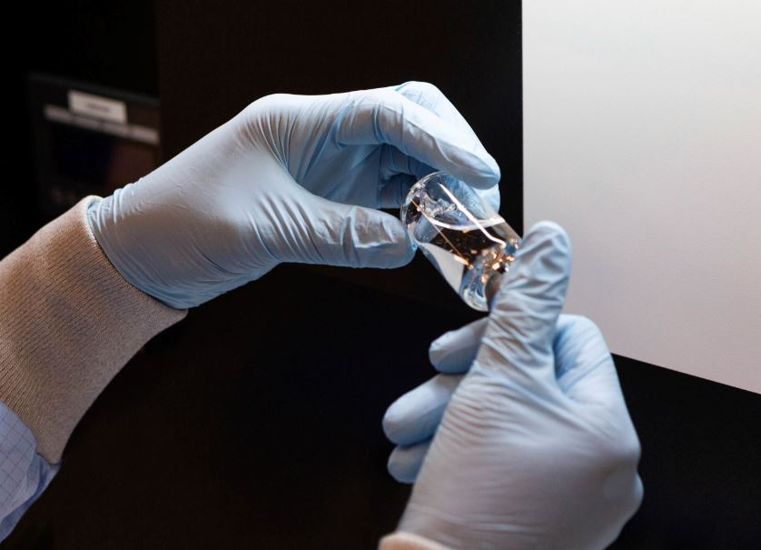In this March 2020 photo provided by Gilead Sciences, a vial of the investigational drug remdesivir is visually inspected at a Gilead manufacturing site in the United States. Given through an IV, the medication is designed to interfere with an enzyme that reproduces viral genetic material. Photo: AP