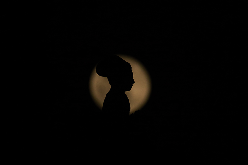 A statue of late King Pratap Malla is pictured against the full moon during the pink super moon spectacle, in Kathmandu, on Wednesday, April 8, 2020. Photo: Skanda Gautam/THT
