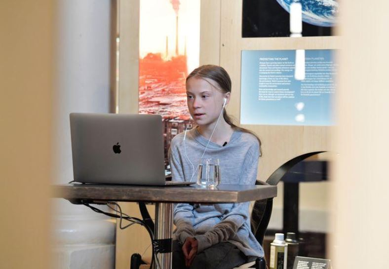 Environmental activist Greta Thunberg participates in a video conversation with Johan Rockstrom, who joins from Germany, about the coronavirus disease (COVID-19) and the environment at the Nobel Museum in Stockholm, Sweden on April 22, 2020. Photo: Reuters