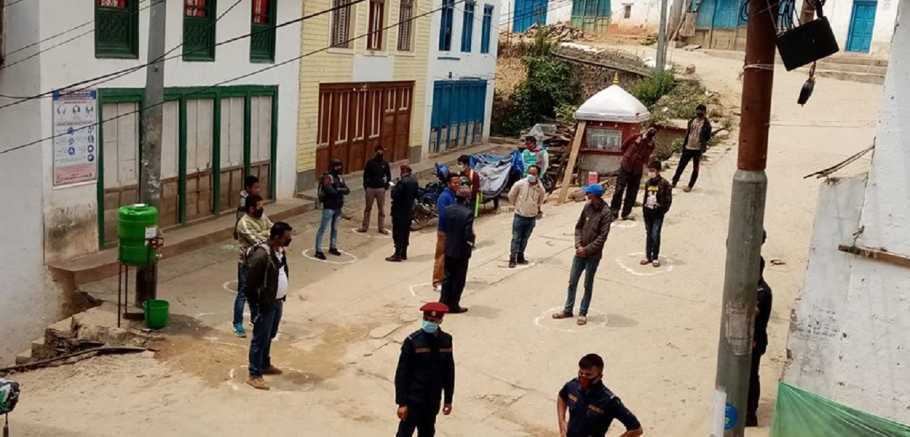 Security personnel spreading awareness regarding COVID-19 and physical distancing among the lockdown offenders, in Bhojpur, on Wednesday, April 15, 2020. Photo: Niroj Koirala/THT