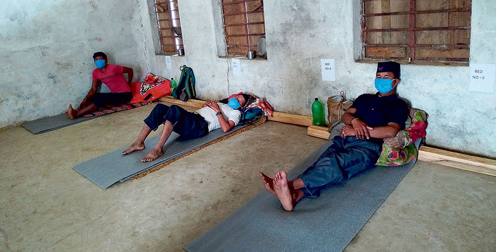 People kept in sub-standard quarantine facilities in Bhojpur district amid concerns over the possible spread of the COVID-19 infection. Photo: Niroj Koirala/THT