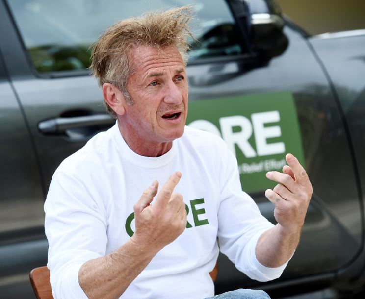 In this April 8, 2020 photo, actor and activist Sean Penn, founder of the nonprofit organization Community Organized Relief Effort, speaks during an interview at his home in Malibu, Calif. The Oscar winner's disaster relief organization called CORE has teamed up with Los Angeles Mayor Eric Garcettiu2019s office and the cityu2019s fire department to safely distribute free drive-through COVID-19 test sites for those with qualifying symptoms. Photo: AP