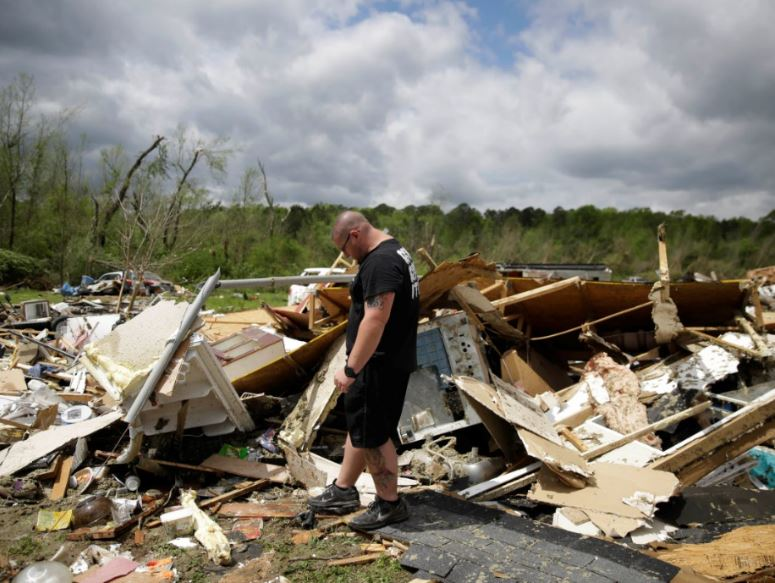 Aaron Pais kicks around debris at a mobile home park after a tornado hit on Monday, April 13, 2020, in Chatsworth, Ga. Severe weather has swept across the South, killing multiple people and damaging hundreds of homes from Louisiana into the Appalachian Mountains. Many people spent part of the night early Monday sheltering in basements, closets and bathroom tubs as sirens wailed to warn of possible tornadoes. Photo: AP