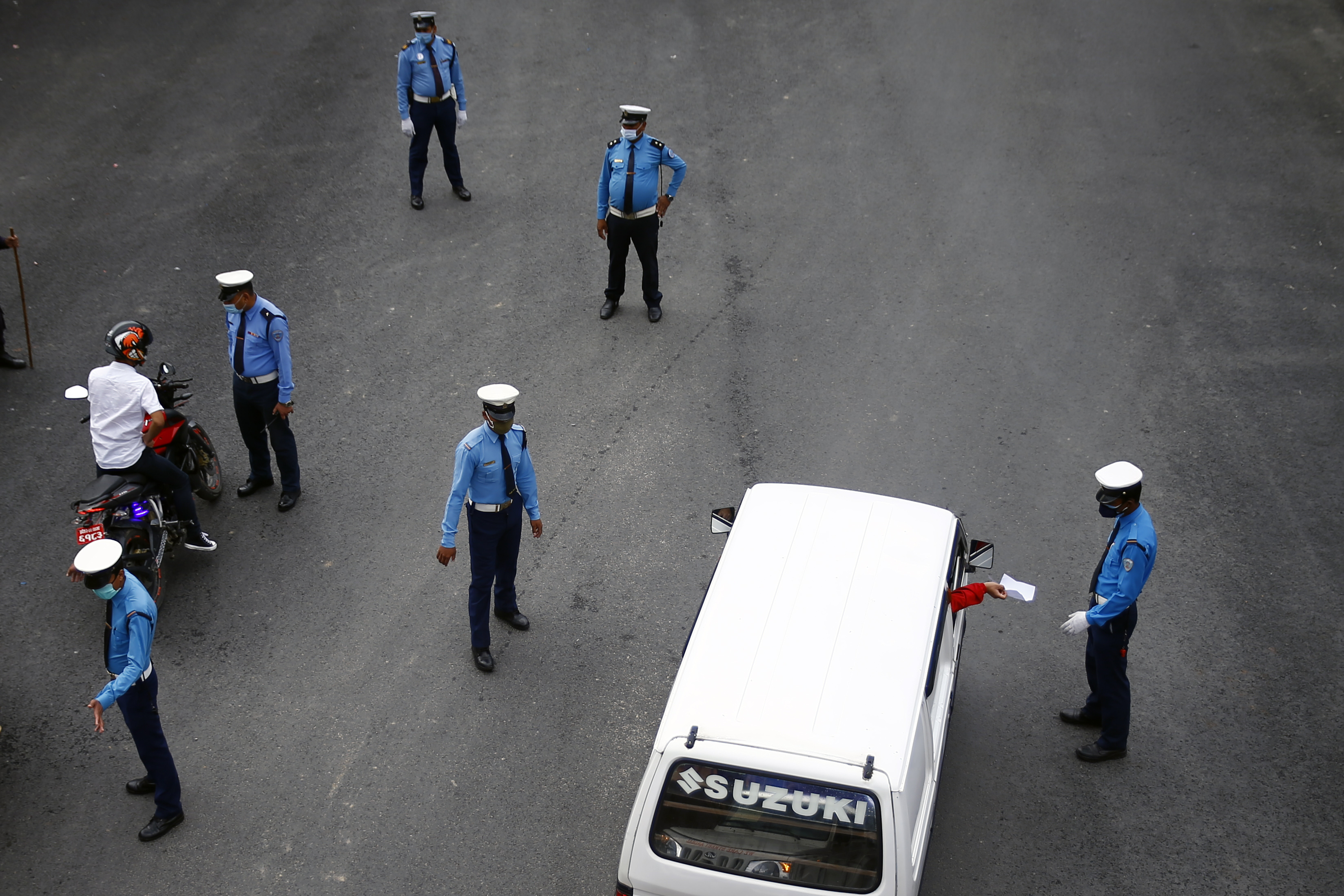 Policemen checking vehicles for passes on the 44th day of the nationwide lockdown amid  concerns about the spread of  COVID-19, in Kathmandu,  on Wednesday, May 6, 2020. Photo: Skanda Gautam/ THT