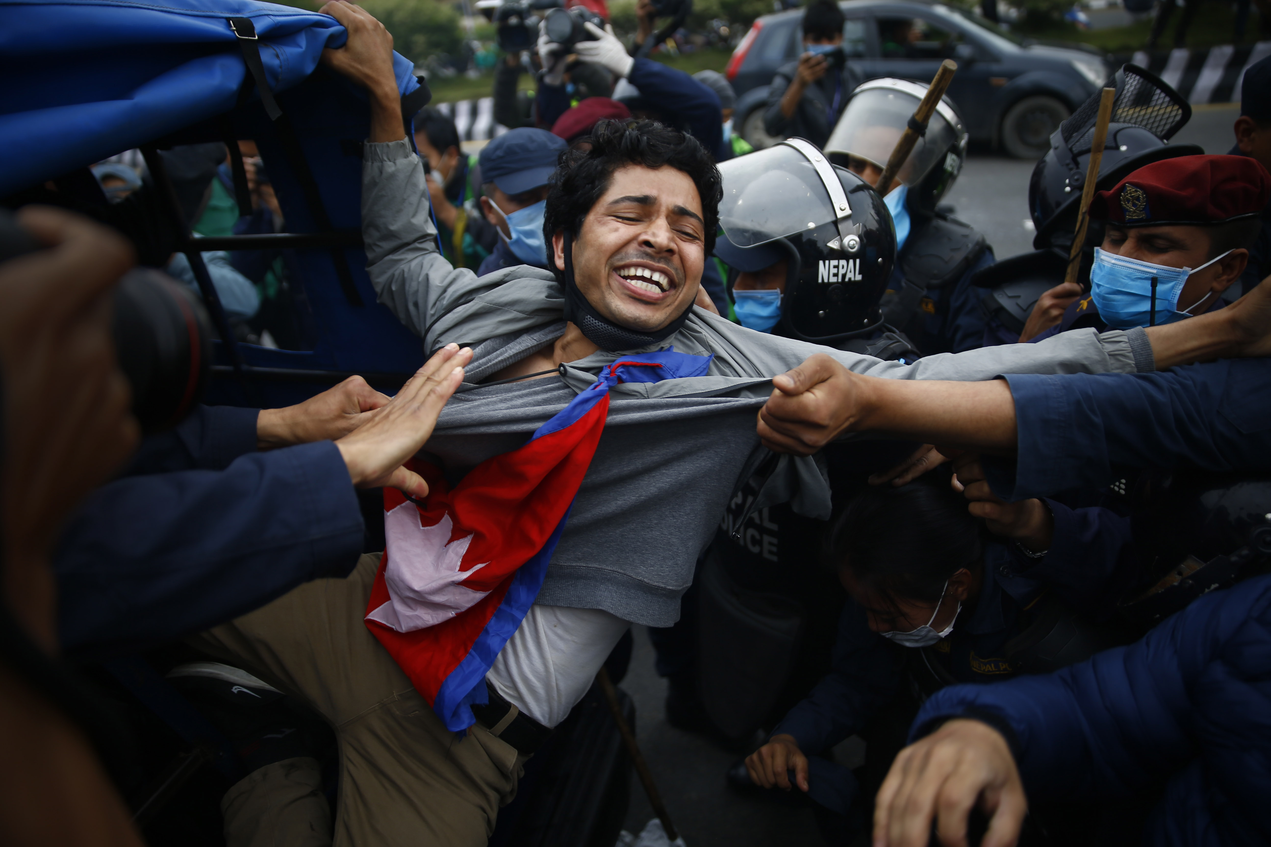 Police arrest student agitators after they burn an effigy of Indian Prime Minister Narendra Modi following Indian government's recent inauguration of a link road to Mansarovar of Tibet in China via Lipulekh region, a Nepali territory, in Kathmandu, on Monday, May 11, 2020. Photo: Skanda Gautam/THT