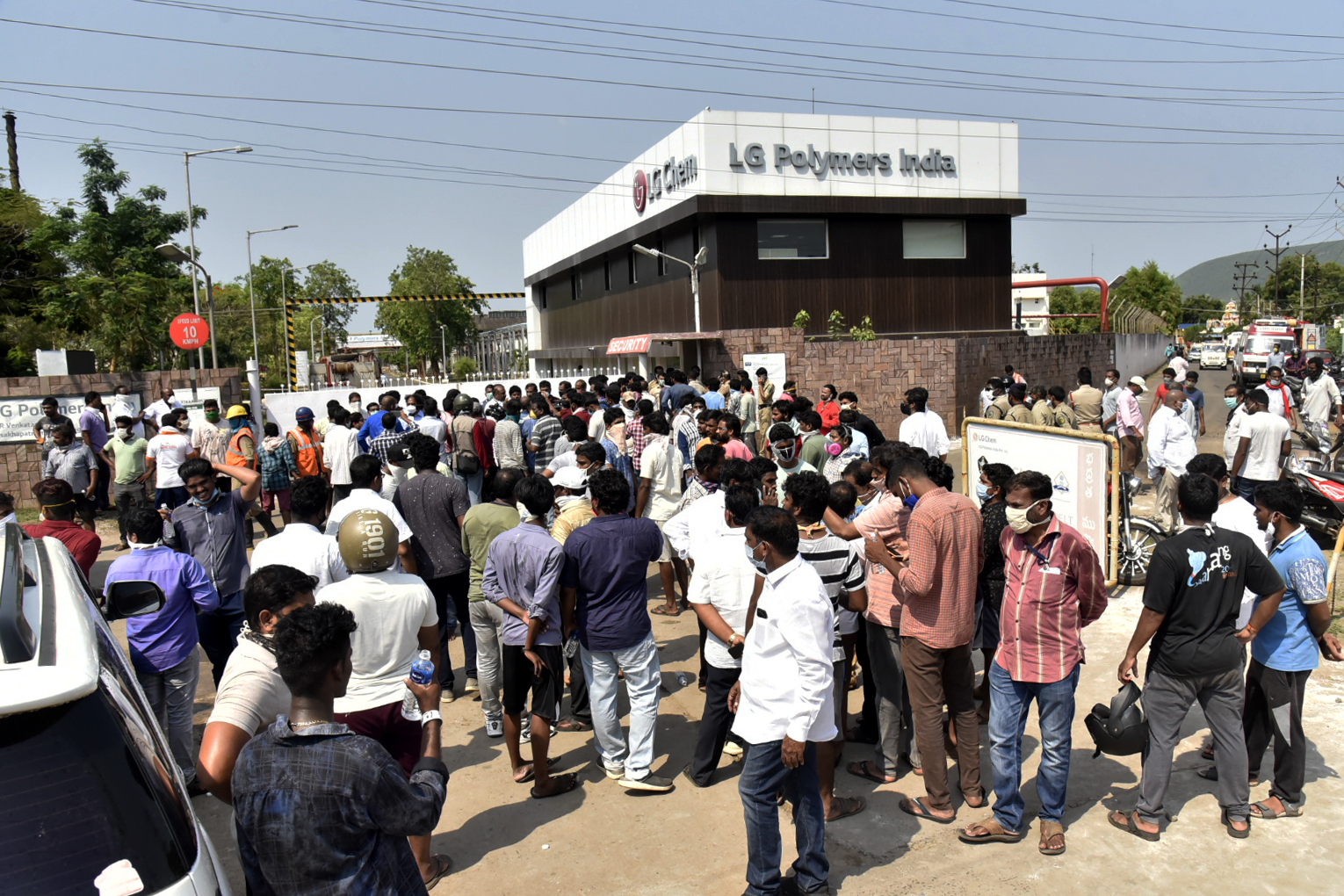 A crowd gathers outside the LG Polymers plant from where chemical gas leaked in Vishakhapatnam, India, Thursday, May 7, 2020. Synthetic chemical styrene leaked from the industrial plant in southern India early Thursday, leaving people struggling to breathe and collapsing in the streets as they tried to flee. Administrator Vinay Chand said several people fainted on the road and were rushed to a hospital. Photo: AP