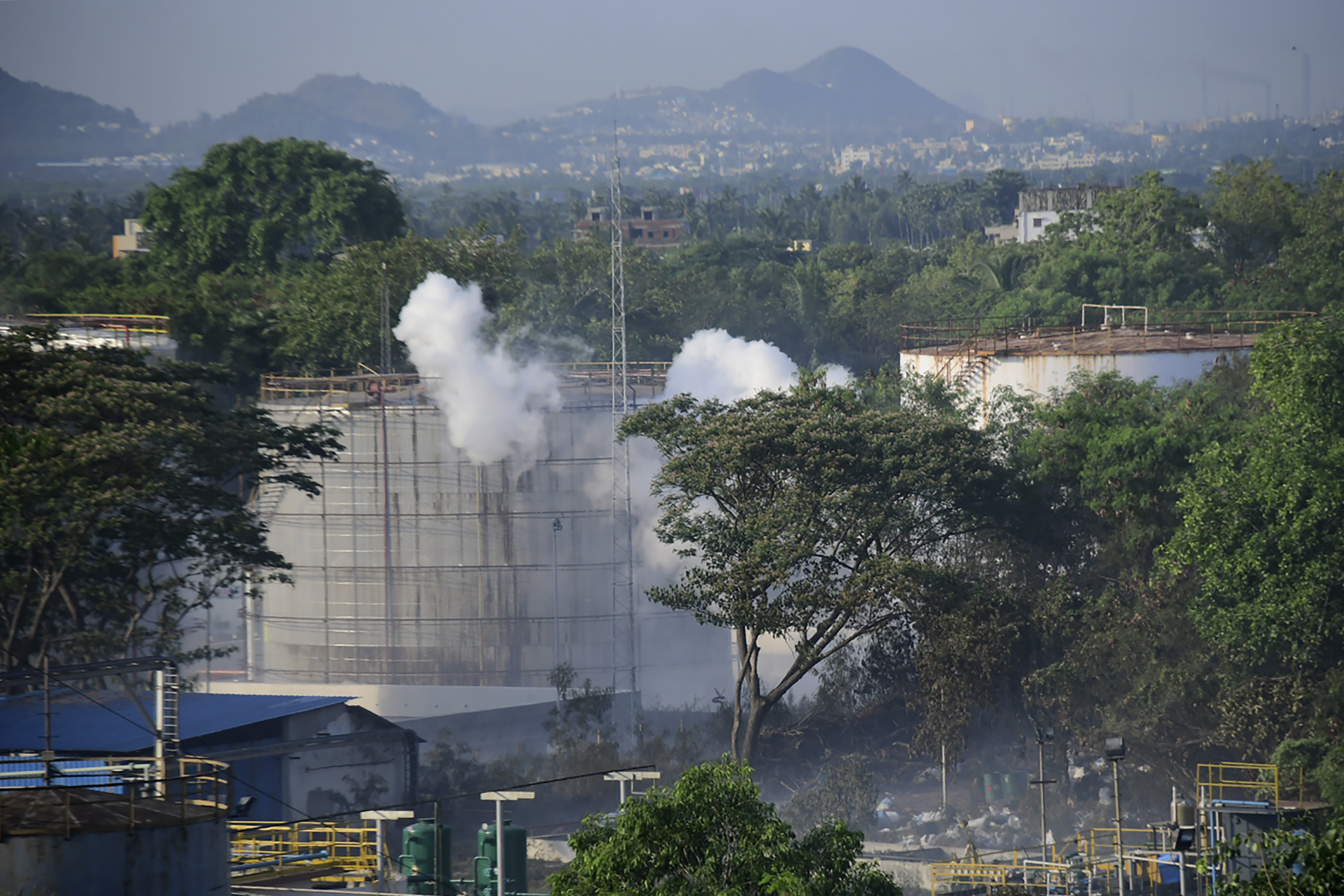 Smoke rises from LG Polymers plant, the site of a chemical gas leakage, in Vishakhapatnam, India, Thursday, May 7, 2020. Photo: AP