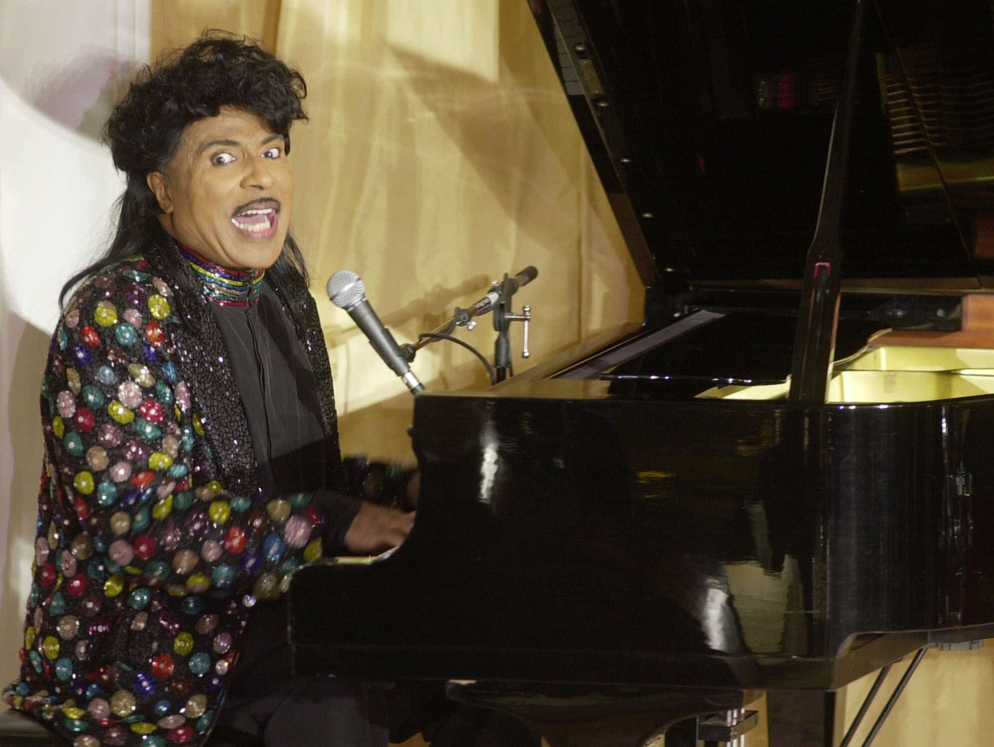 Little Richard performs at the 93rd birthday and 88th year in show business gala celebration for Milton Berle, in Beverly Hills, Calif. Little Richard, the self-proclaimed u201carchitect of rock u2018nu2019 rollu201d whose piercing wail, pounding piano and towering pompadour irrevocably altered popular music while introducing black R&B to white America, has died Saturday, May 9, 2020. File Photo: AP
