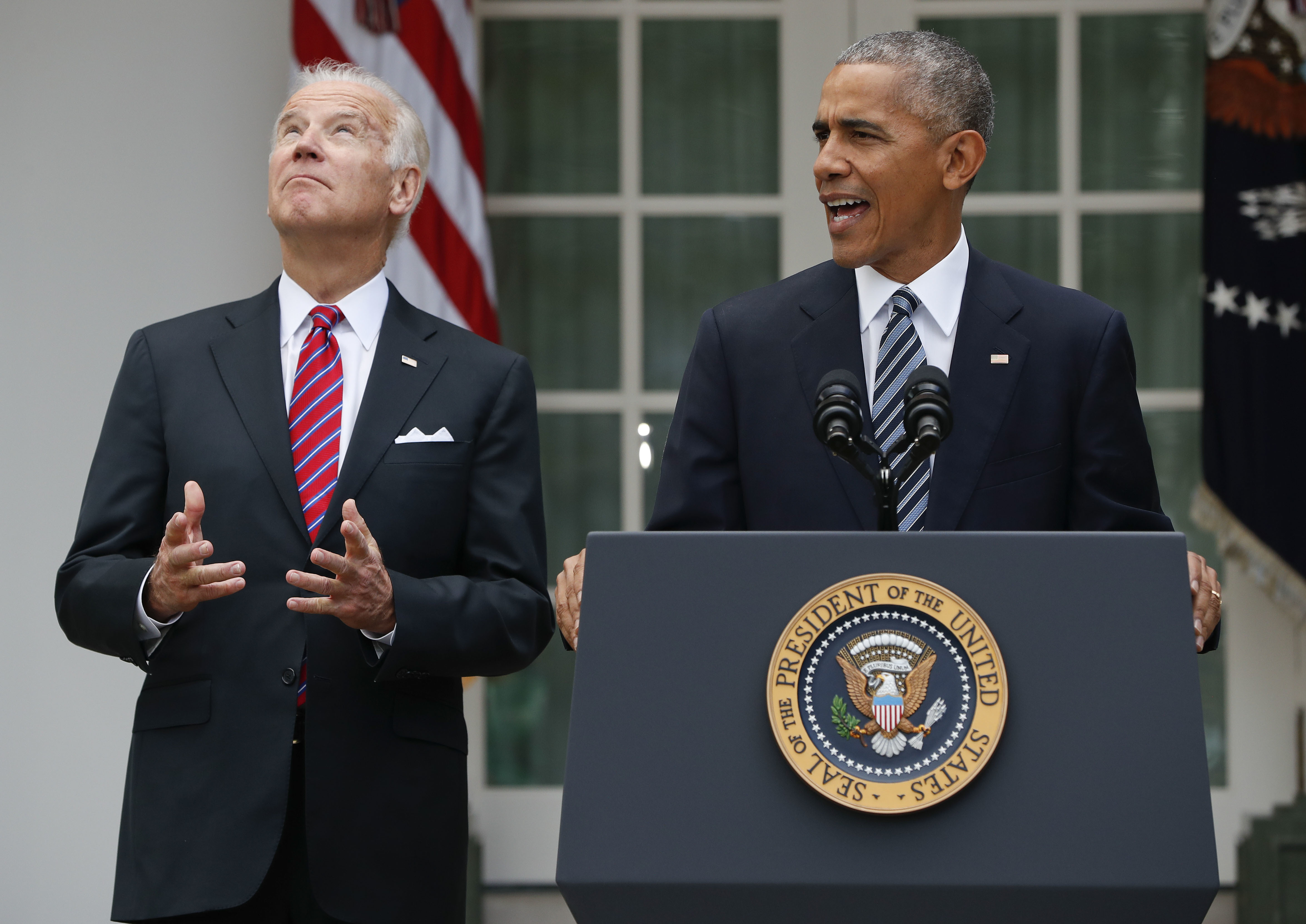 Vice President Joe Biden, left, looks upwards while listening to President Barack Obama speak in the Rose Garden of the White House in Washington. Nearly eight years after he was last on the ballot, Obama is emerging as a central figure in the 2020 presidential election. Democrats are eagerly embracing Obama as a political wingman for Joe Biden, who spent two terms by his side as vice president. Obama remains the partyu2019s most popular figure, particularly with black voters and younger Democrats. File Photo: AP