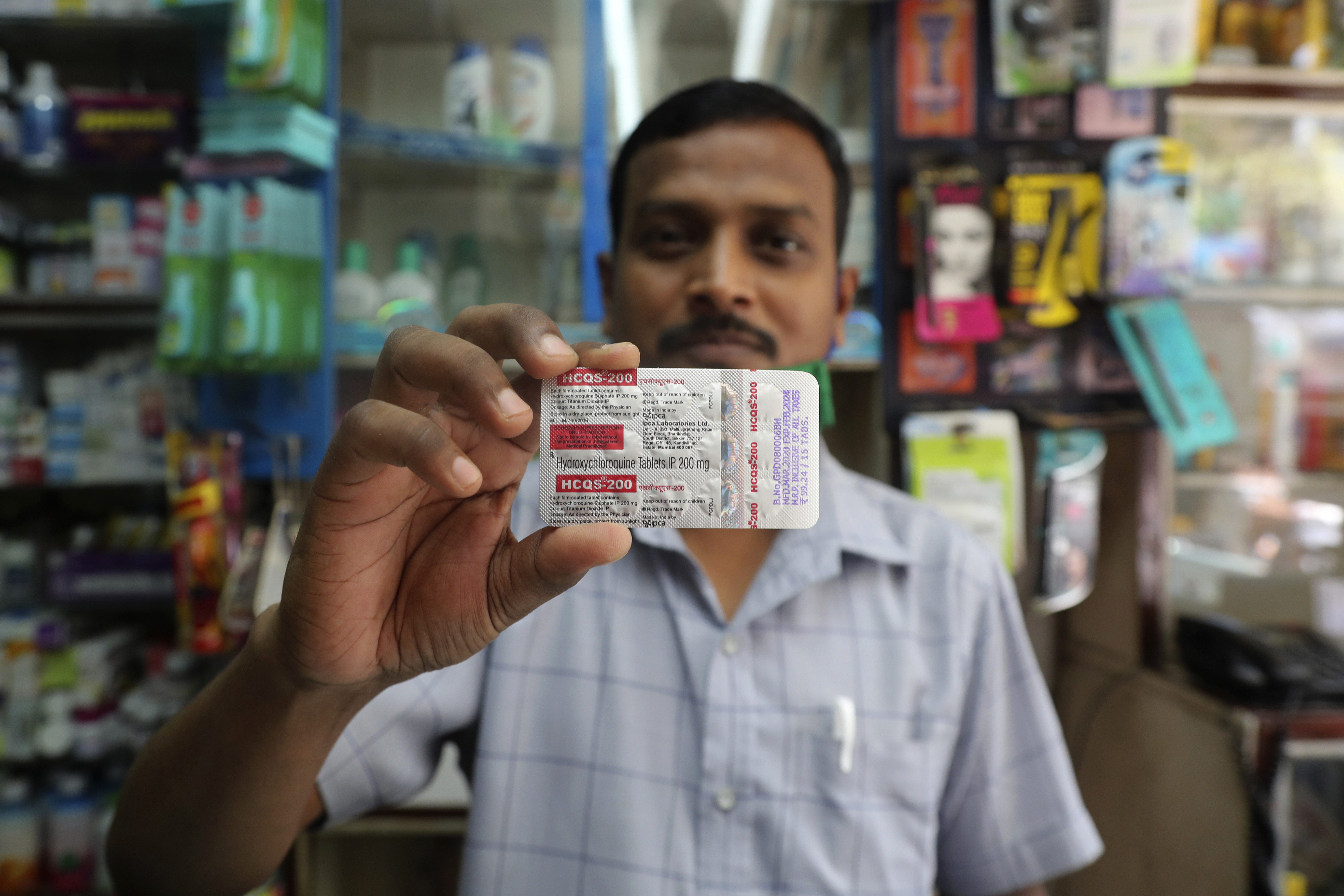 A chemist displays hydroxychloroquine tablets in Mumbai, India, Tuesday, May 19, 2020. President Donald Trumpu2019s declaration that he was taking the antimalarial drug of dubious effectiveness to help fend off the coronavirus will be welcomed in India. Trump's previous endorsement of hydroxychloroquine catalyzed a tremendous shift in the South Asian country, spurring the worldu2019s largest producer of the drug to make much more of it, prescribe it for front-line health workers treating cases of the coronavirus and deploy it as a diplomatic tool, despite mounting evidence against using the drug for COVID-19. (AP Photo/Rafiq Maqbool)