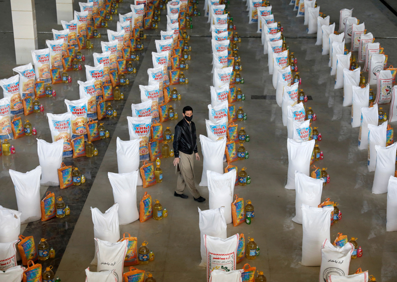 An Afghan man stands among bags of free food donated for people in need, during the coronavirus disease (COVID-19) outbreak in Kabul, Afghanistan April 22, 2020.  Photo: Reuters