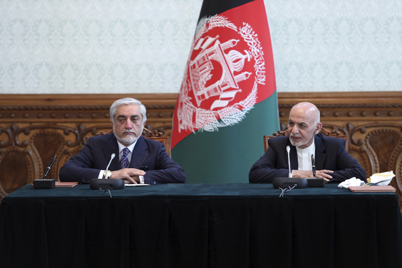 Afghan President Ashraf Ghani, right, and political rival Abdullah Abdullah, speak after they signed a power-sharing agreement at the presidential palace in Kabul, Afghanistan, Sunday, May 17, 2020. Ghani and Abdullah signed the power-sharing agreement eight months after both declared themselves the winner of last September's presidential election. Sediq Sediqqi tweeted Sunday that a political deal between Ghani and Abdullah had been signed in which Ghani would remain president of the war-torn nation and Abdullah would lead the country's National Reconciliation High Council. Photo: Afghan Presidential Palace via AP