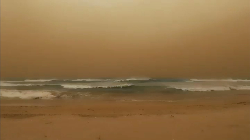 Waves crash to shore as a dust storm blows towards the sea in Geraldton, Western Australia, in this still image taken from a May 24, 2020 video obtained from social media. Photo: Chris Lewis/via Reuters