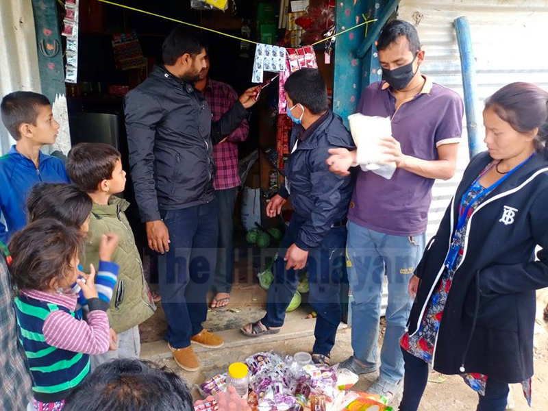 Officials insecting the products in a shop in Bajura, on Frday, May 08, 2020. Photo: Prakashh Singh/THT