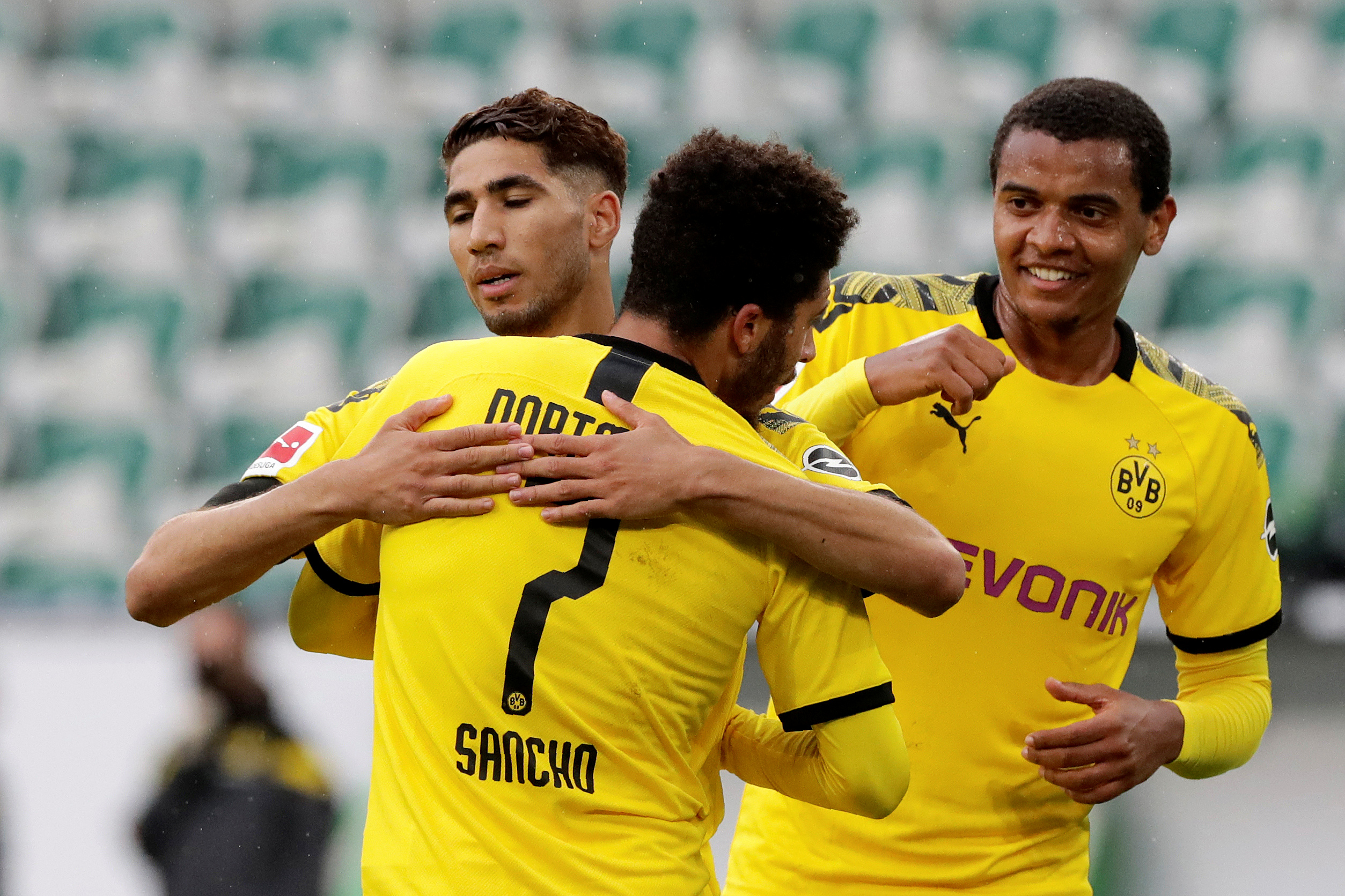 Borussia Dortmund's Achraf Hakimi celebrates scoring their second goal with Jadon Sancho, as play resumes behind closed doors following the outbreak of the coronavirus disease (COVID-19) during the Bundesliga match between VfL Wolfsburg and Borussia Dortmund, at Volkswagen Arena, in Wolfsburg, Germany, on May 23, 2020. Photo: Michael Sohn/Pool via Reuters