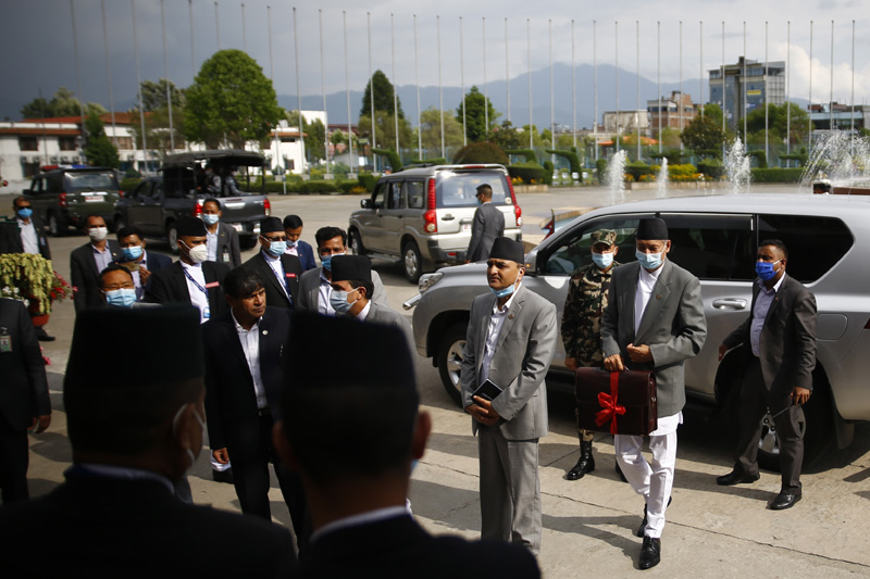 Finance Minister Yubaraj Khatiwada arrives with the 'budget briefcase' for the fiscal year 2020-21 at the joint meeting of House of Representatives and the National Assembly at Federal Parliament in Kathmandu on Thursday, May 28, 2020. Photo: Skanda Gautam/THT