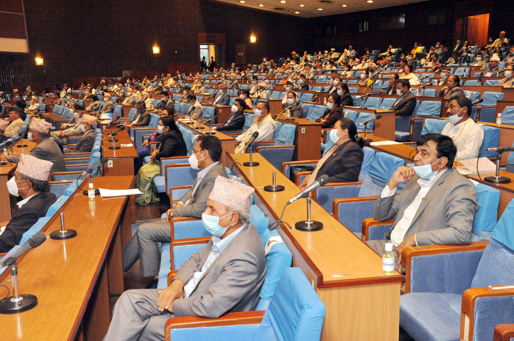 Ministers and parliamentarians take part in the in the joint session of the House of Representatives and National Assembly where Finance Minister Yubaraj Khatiwada presented a budget of Rs 1,474.64 billion for the Fiscal Year 2020/2021, in New Baneshwor, Kathmandu, on Thursday, May 28, 2020. Photo: RSS
