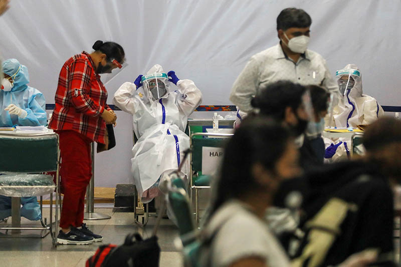 Indian nationals, who were stranded in Singapore due to the coronavirus disease (COVID-19) outbreak, are seen along with medics wearing personal protective equipment (PPE) at the airport, upon their arrival in New Delhi, India, May 8, 2020. Photo: Reuters