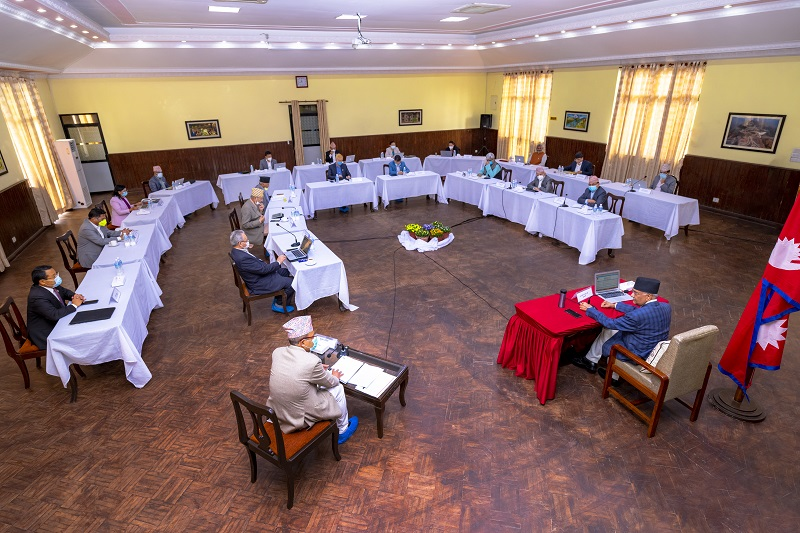 Ministers take part in the Cabinet meeting held at PM's official residence in Baluwatar, Kathmandu, on Wednesday, May6, 2020. Photo courtesy: PM's Secretariat