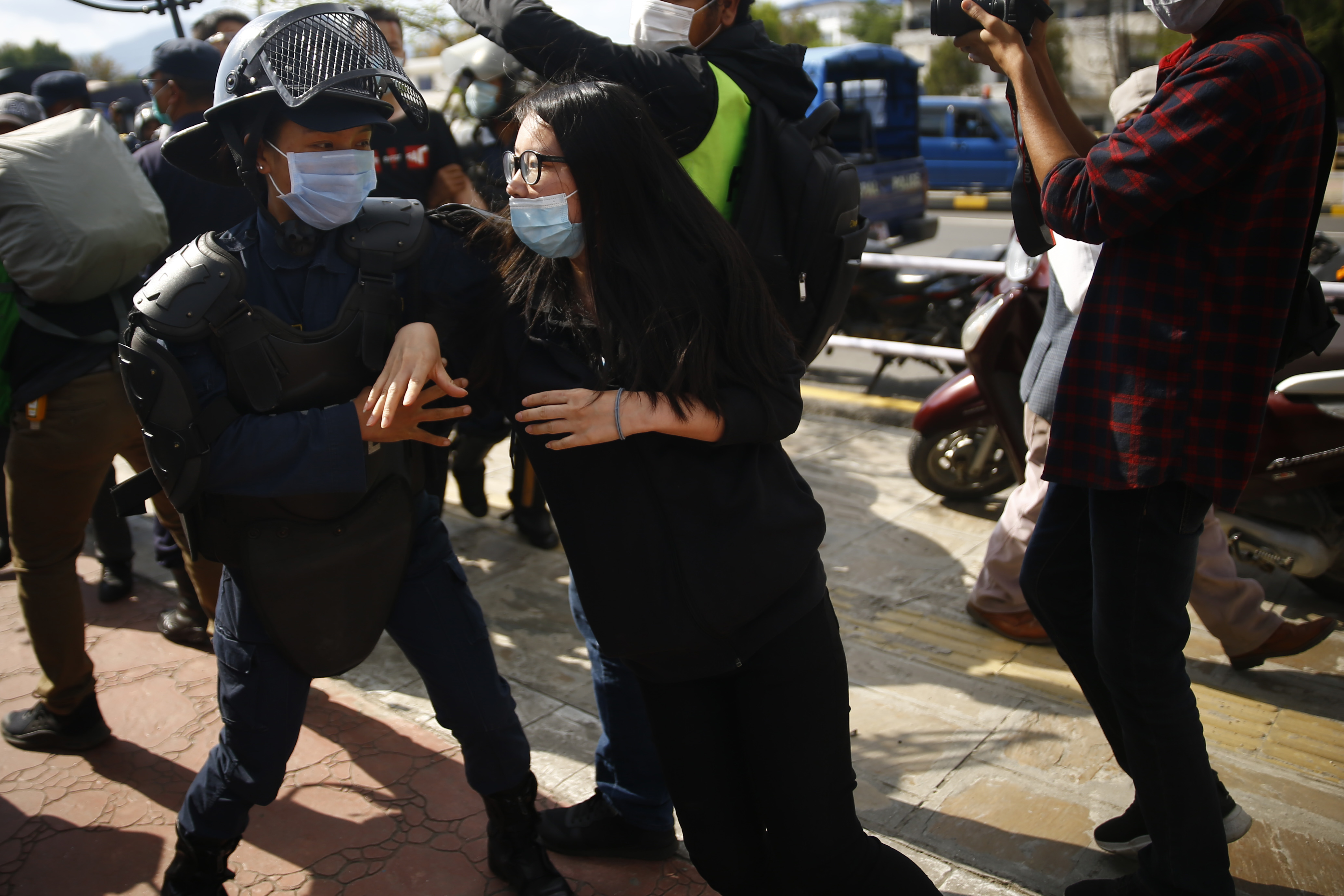 Chinese nationals clashed with police personnel today at Singha Durbar gate where the former were staging demonstrations demanding repatriation flights to their country. As many as six, including four police personnel, were injured in the clash. Photo: Skanda Gautam/THT