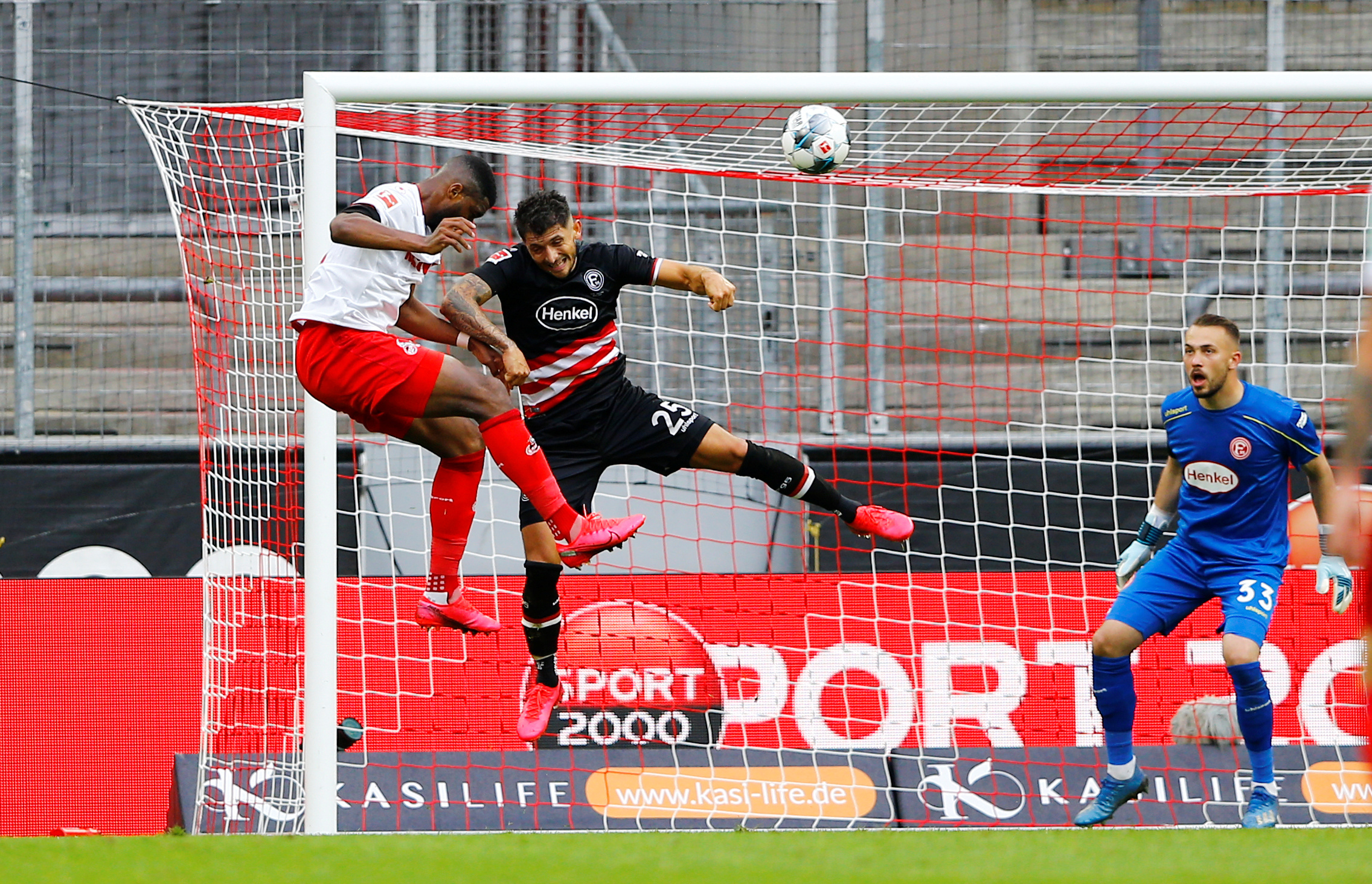 FC Cologne's Anthony Modeste scores their first goal, as play resumes behind closed doors following the outbreak of the coronavirus disease (COVID-19) during the Bundesliga match between FC Cologne and Fortuna Dusseldorf, at  RheinEnergieStadion, in Cologne, Germany, on May 24, 2020. Photo: Reuters