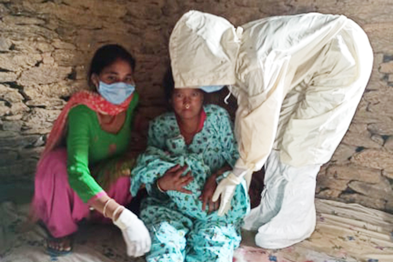 A new mother hoding  her newly born baby in a quarantine centre in Mellekh Rural Municipality-3, Achham district, on Friday, May 29, 2020. Photo: Prakash Singh/THT