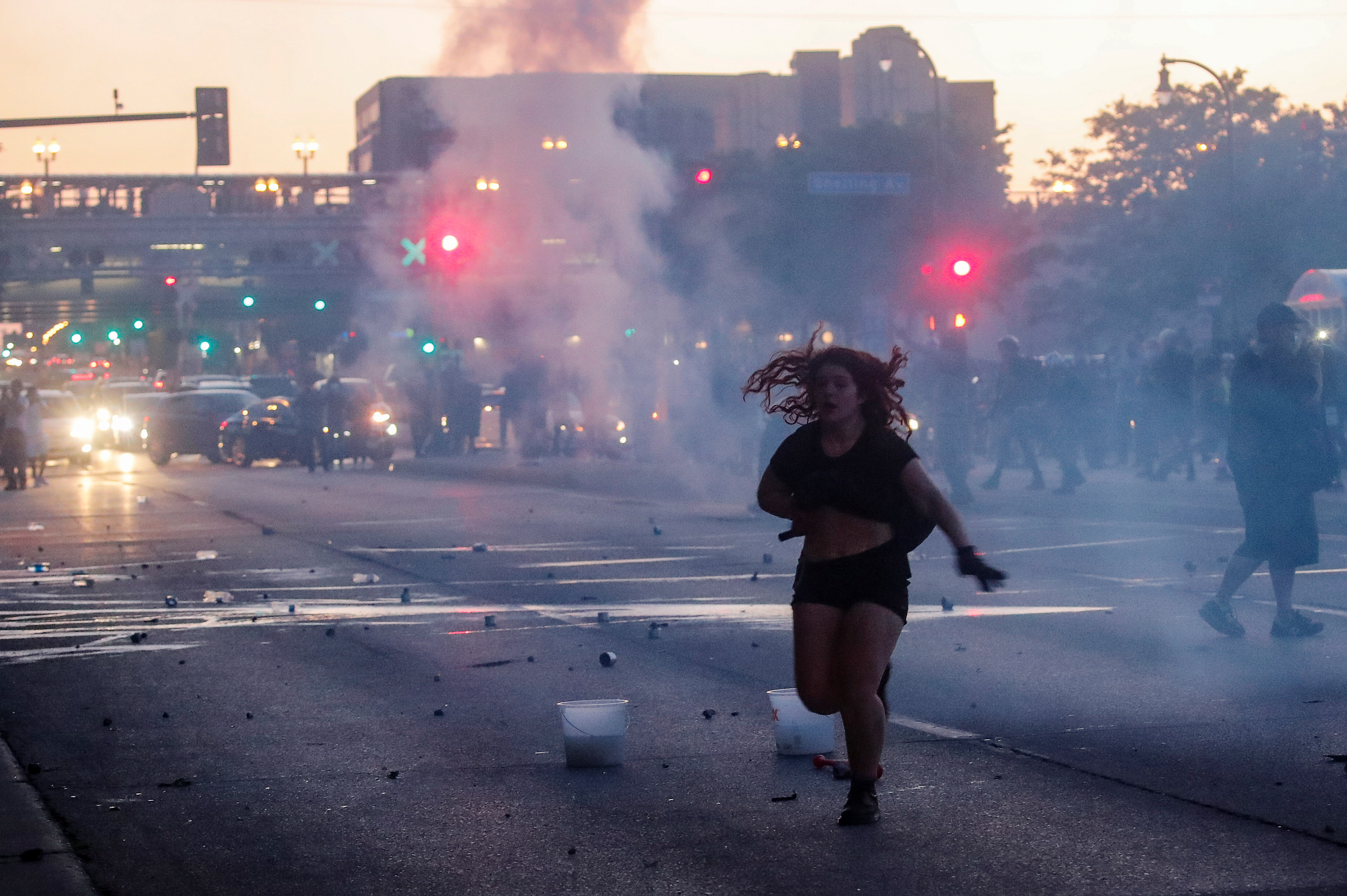 A woman reacts on a street as tear gas is used by riot police to disperse protesters as demonstrations continue after a white police officer was caught on a bystander's video pressing his knee into the neck of African-American man George Floyd, who later died at a hospital, in Minneapolis, Minnesota, US, on May 28, 2020. Photo: AP