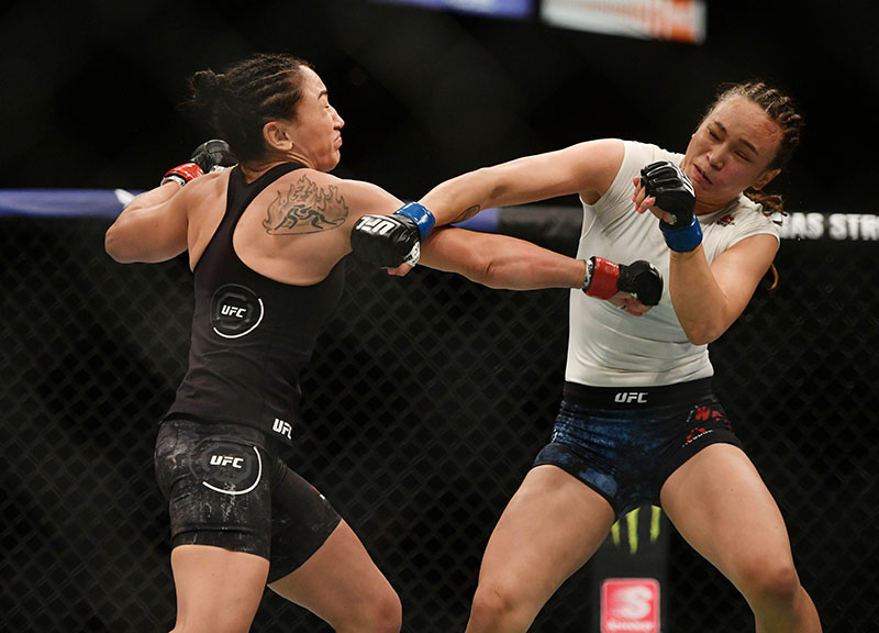 FILE - Carla Esparza (red gloves) fights Michelle Waterson (blue gloves) during UFC 249 at VyStar Veterans Memorial Arena, in Jacksonville, Florida, USA, on May 9, 2020. Photo: Jasen Vinlove-USA TODAY Sports via Reuters