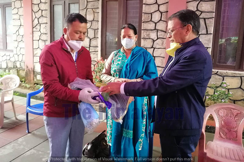 Man Bahadur GC, mayor of Pokhara metropolis, hands over protective gears to cleaning staff on the 39th day of government-imposed lockdown to control the spread of COVID-19, in Pokhara, on Friday, May 01, 2020. Photo: Rishi Ram Baral/THT